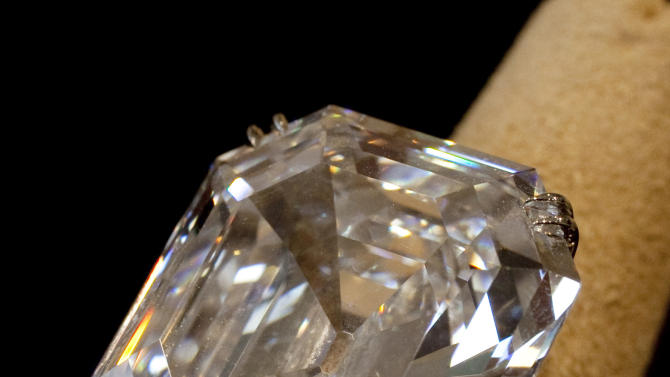 "ADDS DATE OF SALE -  FILE - This , Sept. 1, 2011, file photo shows""The Elizabeth Taylor Diamond,"" a 33.19 carat a gift to the actress from Richard Burton at Christie's, in New York. The 33.19-carat diamond ring given to Elizabeth Taylor by actor Richard Burton sold for over $8.8 million at auction in New York Tuesday Dec. 13, 2011.  (AP Photo/Richard Drew, File)"