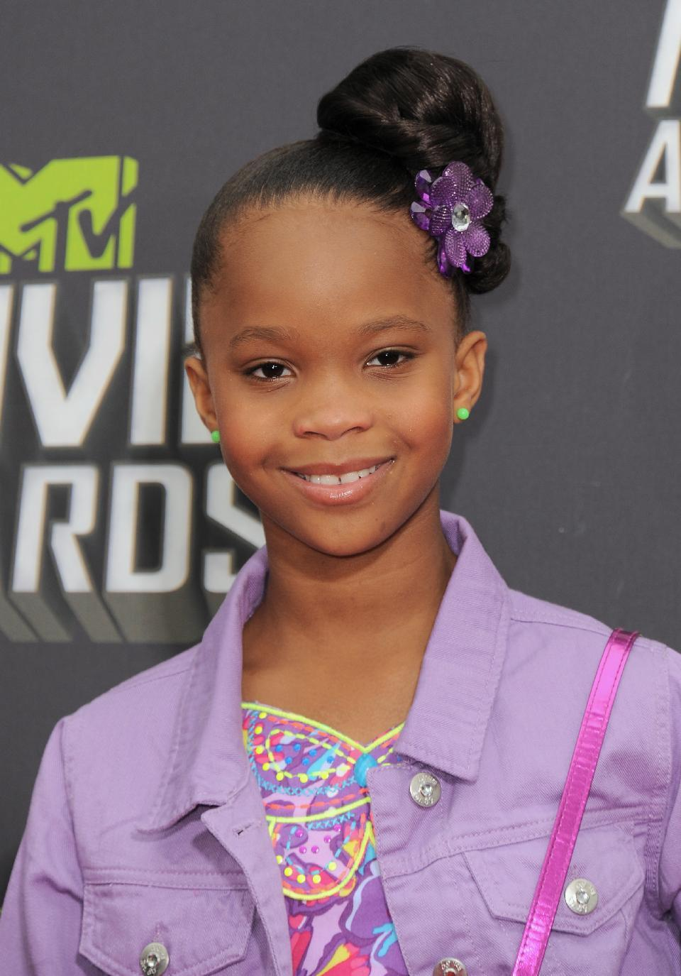 Quvenzhane Wallis arrives at the MTV Movie Awards in Sony Pictures Studio Lot in Culver City, Calif., on Sunday April 14, 2013. (Photo by Jordan Strauss/Invision/AP)