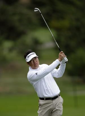 Charlie Wi hits off the first fairway of the Spyglass Hill golf course during the third round of the Pebble Beach National Pro-Am golf tournament Saturday, Feb. 11, 2012, in Pebble Beach, Calif. (AP Photo/Ben Margot)