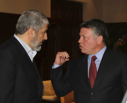 Jordan's King Abdullah chats with senior Hamas leader Khaled Meshaal on his arrival at the Royal Palace in Amman