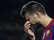 Barcelona&#39;s defender Gerard Pique puts his hand to his head after clashing with Chelsea&#39;s Ivorian forward Didier Drogba on April 24. Pique left hospital Wednesday after being kept in overnight for an accidental bash to the head during the Champions League defeat to Chelsea, the club said