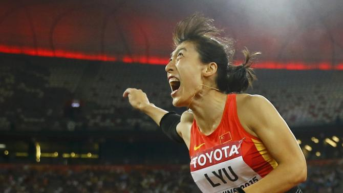 Lyu of China competes in the women's javelin throw final during the 15th IAAF World Championships at the National Stadium in Beijing