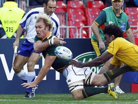 Australia Wallabies' Radike Samo pushes South Africa Springboks' Schalk Burger out of touch during their Rugby World Cup quarter-final match at Wellington Regional Stadium
