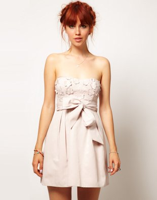 Wrap yourself up in a strapless dress and top it off with a bow!