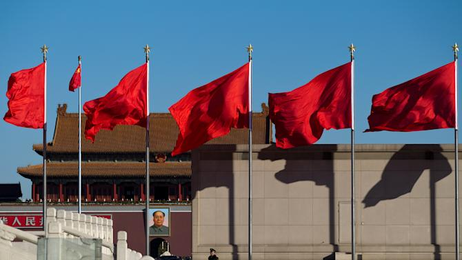 A Chinese paramilitary policeman stands guard on Tiananmen Square while sessions of the National People's Congress and the Chinese People's Political Consultative Conference are held at the Great Hall of the People in Beijing Monday, March 4, 2013. In a rare move, China on Monday declined to reveal its defense budget request for 2013. It has been customarily that the country announces its defense spending plan for a new year at a press conference that is held a day before the opening of an annual session of the National People's Congress, China's parliament. (AP Photo/Andy Wong)