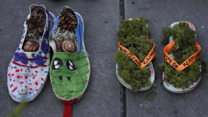 A pair of beach sandals with green moss are symbolically placed on the Place de la Republique, after the cancellation of a planned climate march following shootings in the French capital, ahead of the World Climate Change Conference 2015 (COP21)