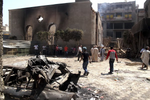 Egyptian gather in the ruins of the Evangelical Church …