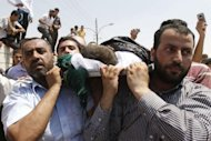 People carry the body of a four-year-old Syrian boy during his funeral in Jordanian town of Ramtha. Syrian rebels staved off a fightback by regime forces in Aleppo on Saturday amid growing concern about the risks of reprisals against civilians in the country's commercial capital