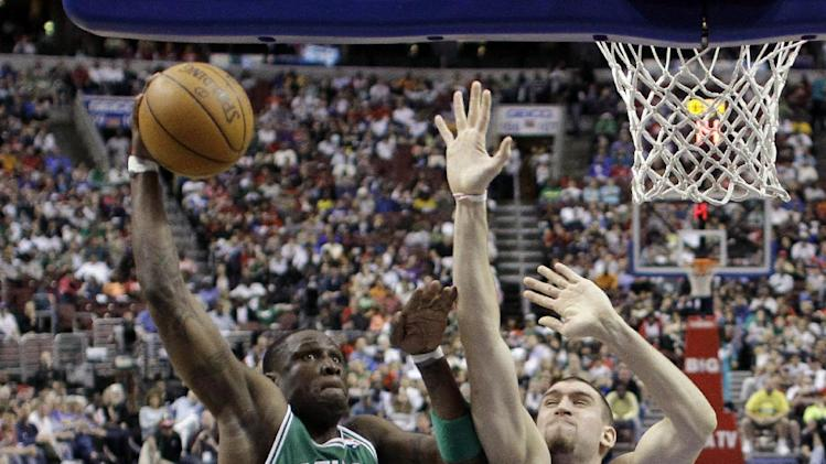 Boston Celtics' Mickael Pietrus (28), of France, goes up for a dunk as Philadelphia 76ers' Spencer Hawes (00) defends in the first half of an NBA basketball game on Friday, March 23, 2012, in Philadelphia. (AP Photo/Matt Slocum)