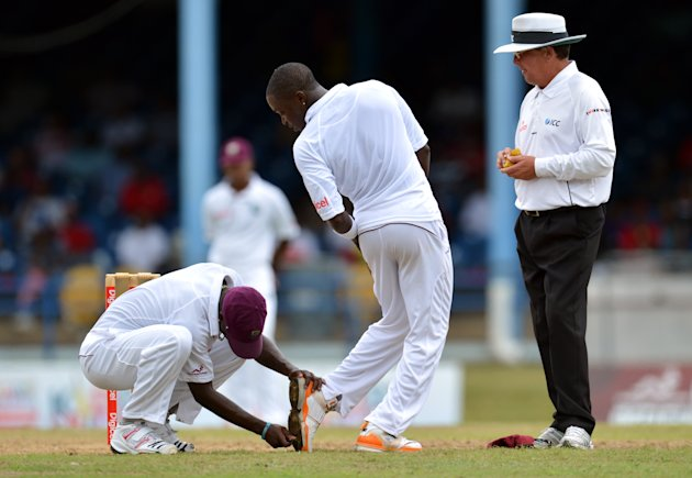 West Indies bowler Fidel Edwards (C) get