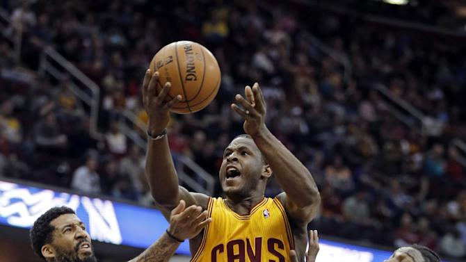 Cleveland Cavaliers' Dion Waiters (3) shoots between Denver Nuggets' Wilson Chandler, left, and Kenneth Faried in the second quarter of an NBA basketball game Saturday, Feb. 9, 2013, in Cleveland. (AP Photo/Mark Duncan)