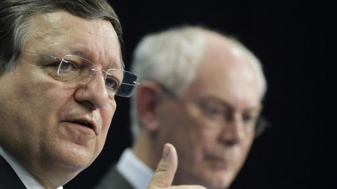 Outgoing European Council President Van Rompuy and outgoing European Commission President Barroso attend a news conference after an EU summit in Brussels