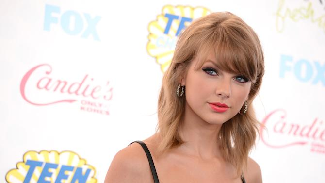 """FILE - This Aug. 10, 2014 file photo shows Taylor Swift at the Teen Choice Awards at the Shrine Auditorium in Los Angeles. Swift says she's releasing her first full-length pop album on Oct. 27. The 24-year-old revealed in a livestream via Yahoo! on Monday , Aug, 18, that """"1989,"""" named after her birth year, is her """"first documented official pop album."""" (Photo by Jordan Strauss/Invision/AP, File)"""