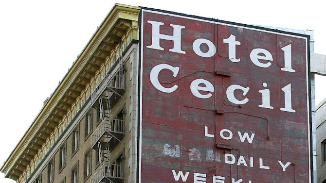 Hotel Cecil in Los Angeles is seen in a Wednesday Feb. 20,2013 photo. Police say the body of a woman found Tuesday wedged in a water tank on the roof of the Hotel Cecill is that of a missing Canadian guest. Investigators used body markings to identify 21-year-old Elisa Lam, police spokeswoman Officer Diana Figueroa said late Tuesday.  A maintenance worker at the Cecil Hotel found the body earlier in the day after guests complained of low water pressure. (AP Photo/Nick Ut)