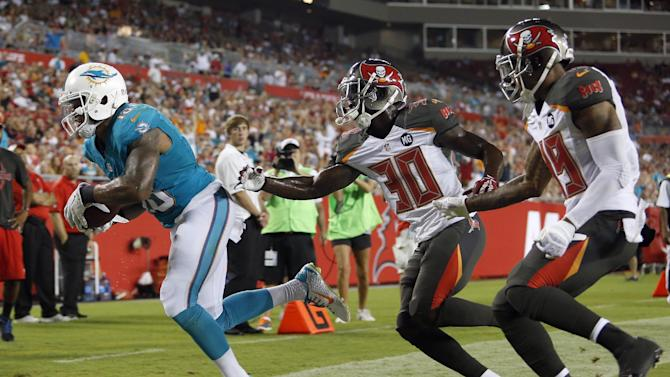 Dolphins get 1st preseason win, top Bucs 20-14
