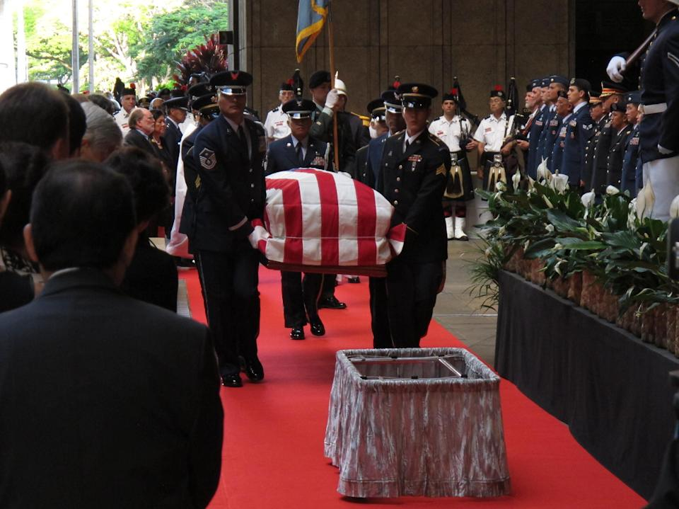 Pallbearers carry the casket of U.S. Sen. Daniel Inouye into the courtyard of the Hawaii state Capitol during a visitation ceremony in Honolulu on, Saturday Dec. 22, 2012. (AP Photo/Oskar Garcia)