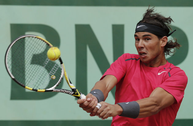 Spain's Rafael Nadal returns the ball to compatriot David Ferrer during their semifinal match in the French Open tennis tournament at the Roland Garros stadium in Paris, Friday, June 8, 2012. (AP Phot