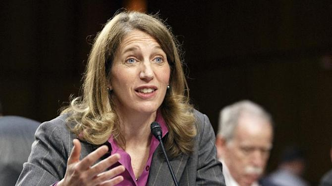 Sylvia Mathews Burwell, President Barack Obama's nominee to become secretary of Health and Human Services testifying on Capitol Hill in Washington. More than 2 million people who got health insurance under President Barack Obama's law have data discrepancies that could jeopardize coverage for some, a government document shows. On Wednesday, Burwell easily passed a key test vote in the Senate. (AP Photo/J. Scott Applewhite, File)