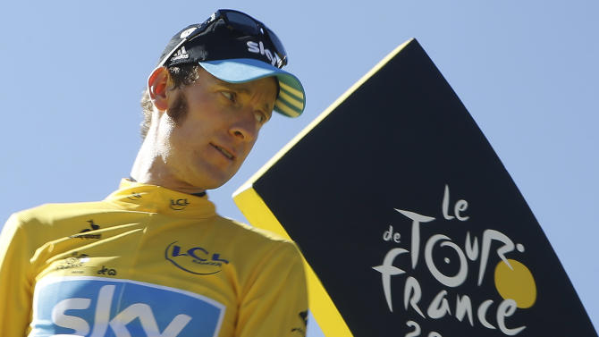 Bradley Wiggins, winner of the 2012 Tour de France cycling race, looks back on the podium in Paris, France, Sunday July 22, 2012. (AP Photo/Laurent Cipriani)