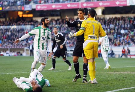 Ronaldo off in Real win as Barca hit six