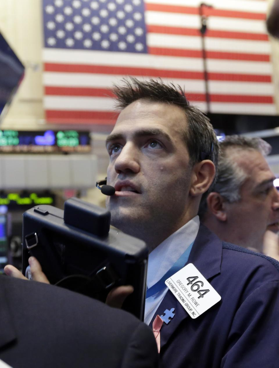 Trader Gregory Rowe works on the floor of the New York Stock Exchange, Friday, Jan. 25, 2013. Stocks are opening higher on Wall Street ahead of what is expected to be more upbeat data on housing from the government. (AP Photo/Richard Drew)