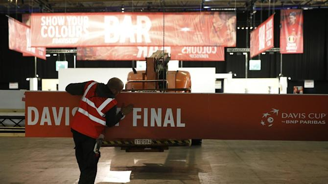 Workmen make final preparations for the Davis Cup Final tennis match between Belgium and Britain, in Ghent, Belgium, Thursday, Nov. 26, 2015. The final starts Friday and runs till Sunday. (AP Photo/Alastair Grant)