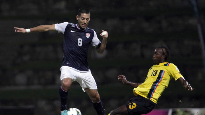 US Clint Dempsey, left, fis challenged by Antigua and Barbuda's Tamorley Kaharie Thomas during a 2014 World Cup qualifying soccer match in St. John, Antigua and Barbuda, Friday, Oct. 12, 2012. (AP Photo/Ricardo Arduengo)