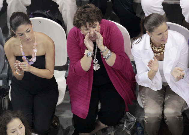 From left, Michael Phelps' girlfriend Nicole Johnson, his mother Debby and his sister Hilary sit in the stands at the FINA Swimming World Championships in Shanghai, China, Monday, July 25, 2011. (AP P