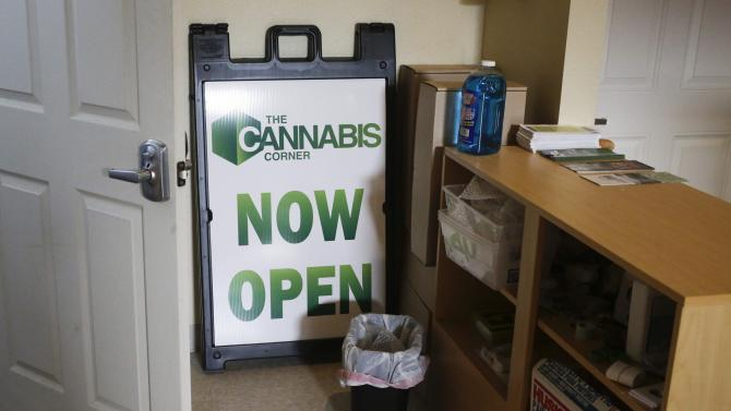 "A ""now open"" sign is seen as The Cannabis Corner makes preparations for their grand opening in North Bonneville"