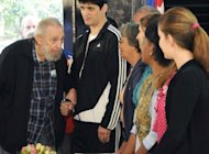 This handout photo from AIN taken February 3, 2013 shows Fidel Castro (L) arriving to vote at a polling station in Havana. The ailing revolutionary leader expressed confidence in the revolution despite a decades-long US trade embargo.