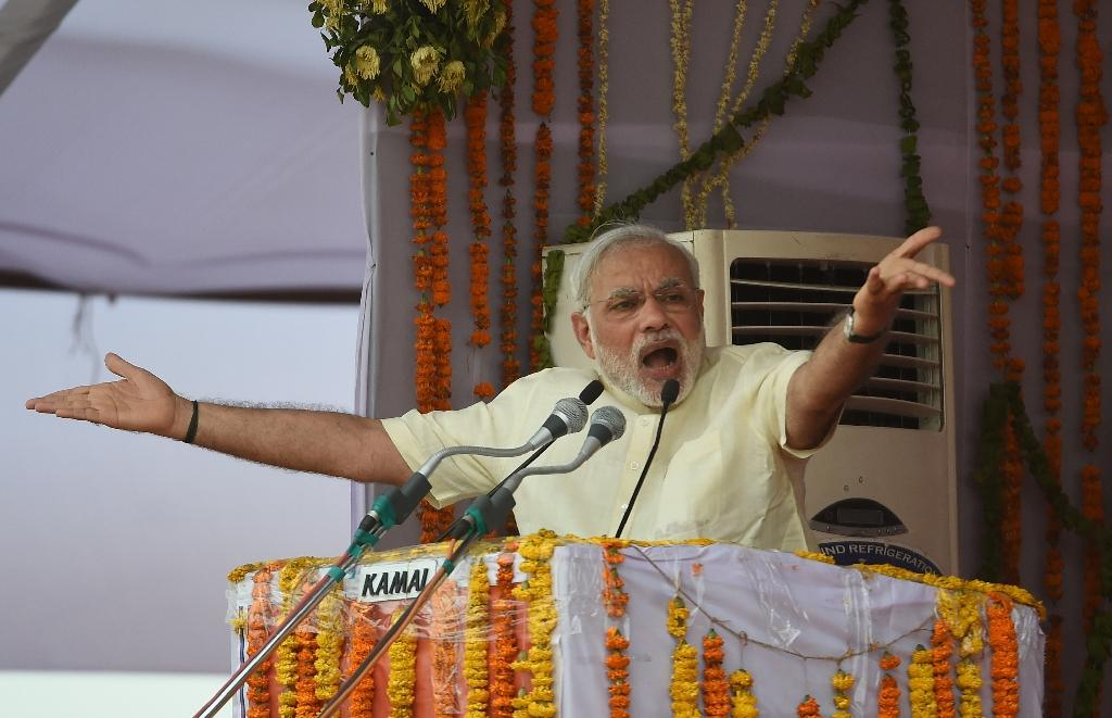 Modi vows to help farmers after land bill standoff