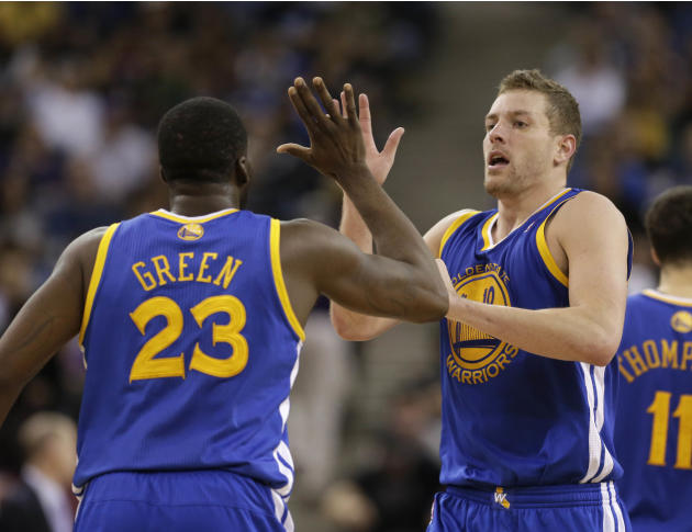 Golden State Warriors Draymond Green, left, and David Lee celebrate in the closing moments of the Warriors 101-92 win over the Sacramento Kings in a NBA basketball game in Sacramento, Calif., Wednesda