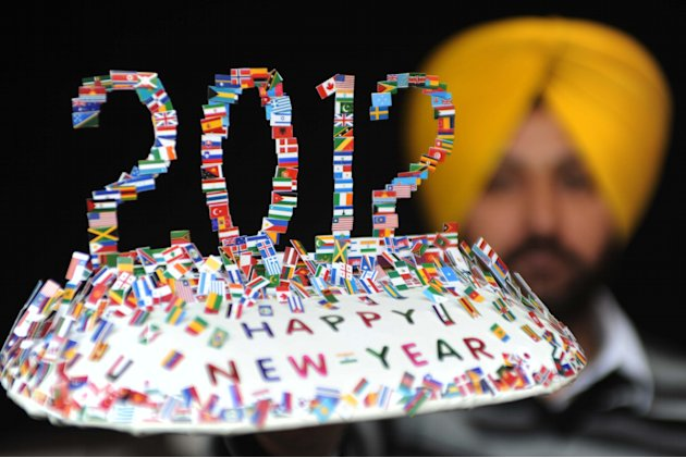 Indian artist Harwinder Singh Gill displays a creation made with 250 national flags