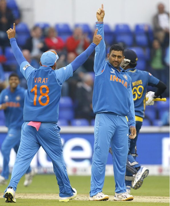 India's captain MS Dhoni, right, appeals during an ICC Champions Trophy semifinal between India and Sri Lanka at the Cardiff Wales Stadium in Cardiff, Thursday, June 20, 2013
