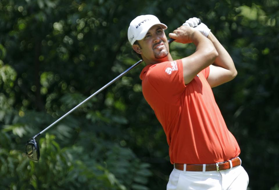 Scott Piercy watches his shot off the second tee during the final round of the John Deere Classic golf tournament at TPC Deere Run, Sunday, July 15, 2012, in Silvis, Ill. (AP Photo/Charlie Neibergall)