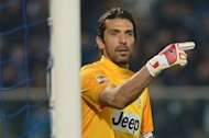 "Juventus goalkeeper Gianluigi Buffon, pictured here on November 10, believes Juve have their destiny in their hands: ""The fact it all depends on us is a good sign. We're at home to Chelsea and then away to Donetsk."""