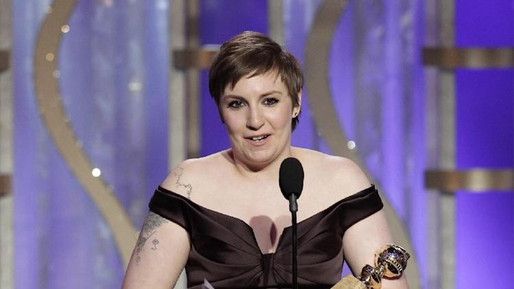 """This image released by NBC shows Lena Dunham with her award for best actress in a TV comedy series for """"Girls,"""" during the 70th Annual Golden Globe Awards at the Beverly Hilton Hotel on Jan. 13, 2013, in Beverly Hills, Calif. (AP Photo/NBC, Paul Drinkwater)"""