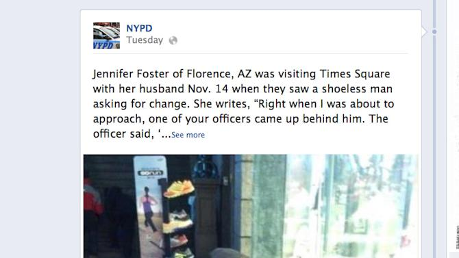"""This screen shot taken from the NYPD Facebook page Thursday Nov. 29, 2012 shows a photo taken by Arizona tourist Jennifer Foster of New York City Police Officer Larry DePrimo presenting a barefoot homeless man in New York's Time Square with boots on Nov. 14, 2012. Foster was visiting New York with her husband on Nov. 14, when she came across the shoeless man asking for change in Times Square. As she was about to approach him, she said the officer  came up to the man with a pair of all-weather boots and thermal socks on the frigid night. She took the picture on her cellphone. It was posted Tuesday night to the NYPD's official Facebook page and became an instant hit. More than 350,000 users """"liked"""" it as of Thursday afternoon, and over 100,000 shared it. (AP Photo/Jennifer Foster via Facebook)"""