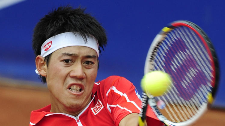 Kei Nishikori of Japan returns the ball to Albert Ramos during the Barcelona open tennis in Barcelona, Spain, Friday, April 26, 2013. Ramos won 6-4, 7-6. (AP Photo/Manu Fernandez)