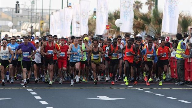 Runners take part in a marathon in Israel's coastal city of Tel Aviv March 30, 2012