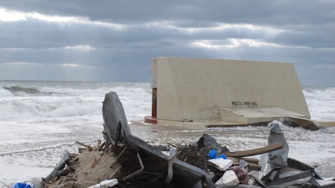 Waves bash against a sewage outfall structure in Point Pleasant Beach N.J. on Thursday, Nov. 15, 2012. Before Superstorm Sandy caused massive beach erosion at the Jersey shore, the outfall had about 50 feet of beach between it and the ocean. Superstorm Sandy took a bite out of the Jersey shore, washing away millions of tons of sand and slimming down beaches along the state's 127-mile coastline. (AP Photo/Wayne Parry)