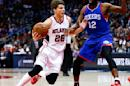 Atlanta Hawks guard Kyle Korver (26) drives against Philadelphia 76ers forward Luc Richard Mbah a Moute (12) in the first half of an NBA basketball game Saturday, Jan. 31, 2015, (AP Photo/John Bazemore)