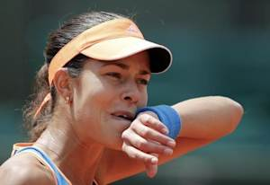 Ana Ivanovic of Serbia reacts during her women's singles match against Lucie Safarova of the Czech Republic at the French Open tennis tournament at the Roland Garros stadium in Paris