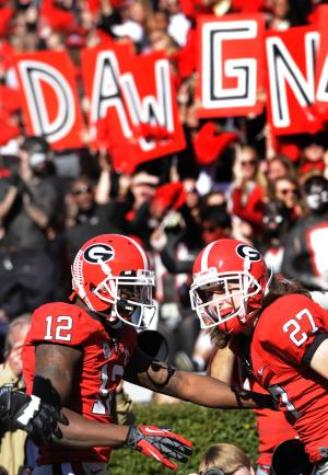 Georgia wide receiver Rhett McGowan (27) celebrates his touchdown reception with wide receiver Tavarres King (12)  during the second quarter of an NCAA college football game against Georgia Tech, Saturday, Nov. 24, 2012, in Athens, Ga. (AP Photo/John Amis)