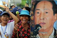 Protesters shout slogans next to a portrait of Mam Sonando (R), owner of Beehive radio station, during a rally near the Phnom Penh municipal court on October 1. He was sentenced to 20 years in prison on Monday for an alleged secessionist plot
