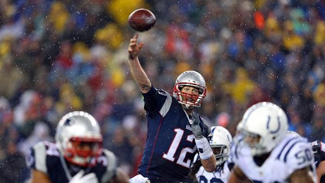 Tom Brady of the New England Patriots throws a touchdown pass against the Indianapolis Colts during the 2015 AFC Championship Game on January 18, 2015 in Foxboro, Massachusetts