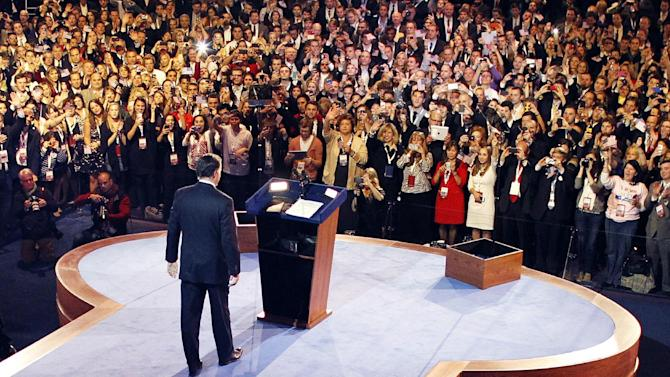 """FILE – In this Nov. 7, 2012, file photo Republican presidential candidate, former Massachusetts Gov. Mitt Romney, arrives to give his presidential election night concession speech in Boston. A 97-page election post-mortem, commissioned by the Republican Party after Romney's loss last fall, said the GOP """"is increasingly marginalizing itself, and unless changes are made, it will be increasingly difficult for Republicans to win another presidential election in the near future."""" (AP Photo/Rick Wilking, Pool)"""