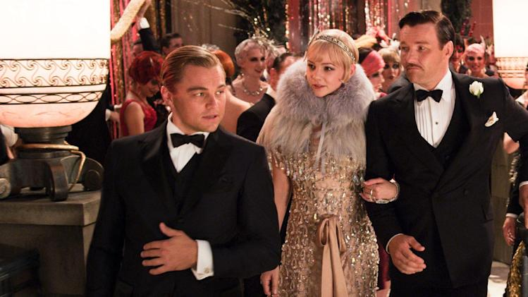 "This undated publicity photo released by courtesy Warner Bros. Pictures shows, from left, Leonardo DiCaprio as Jay Gatsby, Carey Mulligan, as Daisy Buchanan and Joel Edgerton as Tom Buchanan in Warner Bros. Pictures and Village Roadshow Pictures drama, ""The Great Gatsby,"" a Warner Bros. Pictures release. (AP Photo/Warner Bros. Pictures)"