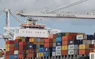 Shipping containers are seen in Oakland, California in March. The US trade deficit narrowed in June for the third straight month, with a slight rise in exports adding to a drop in imports to cut the shortfall, the Department of Commerce said Thursday