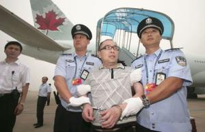 Then Chinese fugitive Lai Changxing is escorted back to Beijing from Canada, at Beijing International Airport